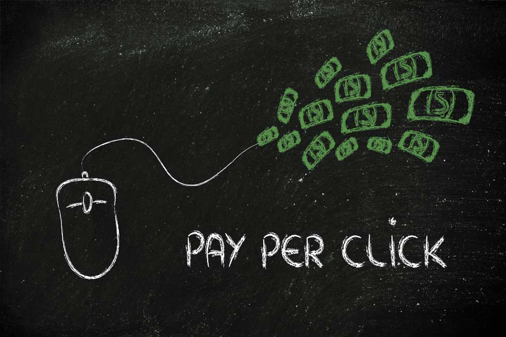 Pay per click written in a blackboard with a mouse and cash drawn on it