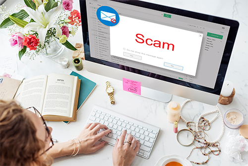 A woman encountering an email scam