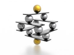 marbles balancing on rectangular platforms stacked on top of each other
