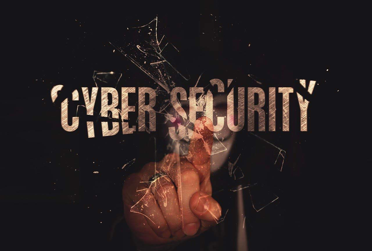 Cybersecurity threat with hacker breaking down cyberdefense