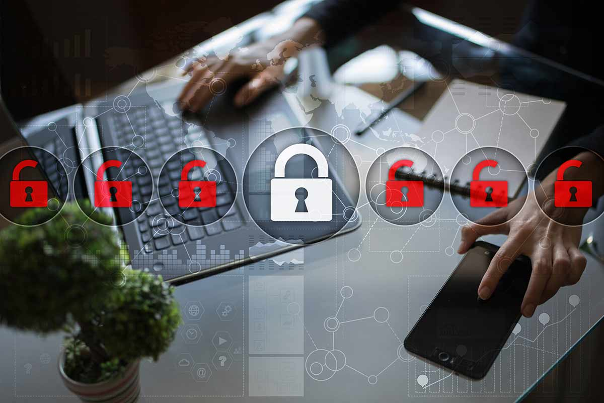 Cybersecurity icons floating over background of employee working on remote network security