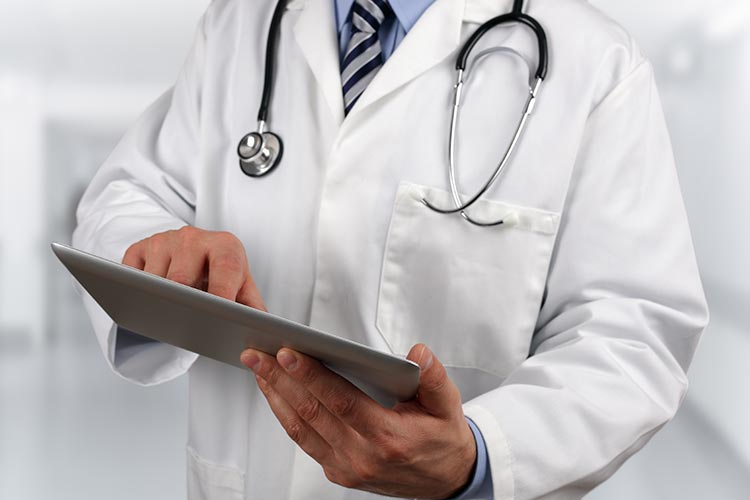 Doctor holding tablet - CST